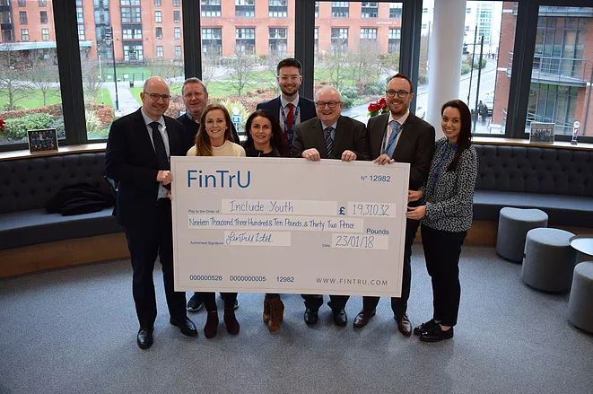Staff from Include Youth receive cheque from friends at FinTrU
